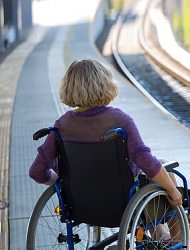 Photo of a wheelchair user on a train platform